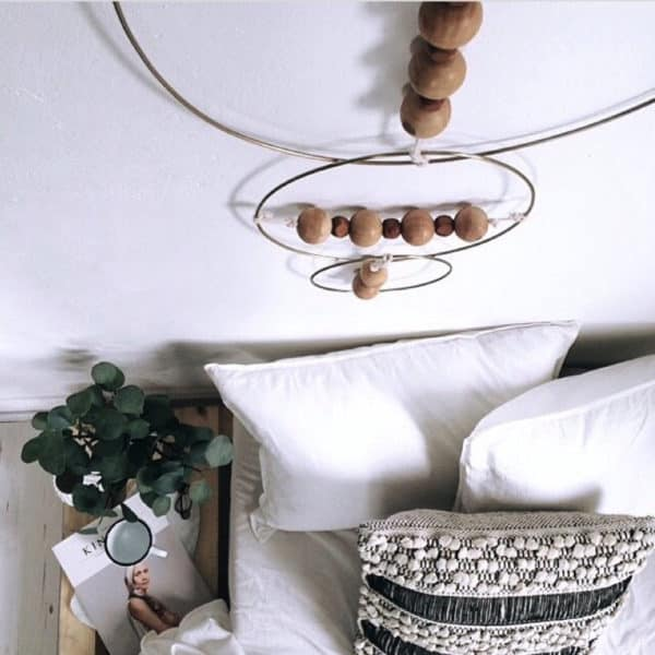 Décoration murale en métal et perle de bois - NORDAL